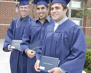Three musketeers: Lowellville graduates, L-R, Brandon Brady, Jacob Paz Rafidi and John Lyras vow, somewhat nervously, to stick together after graduation.
