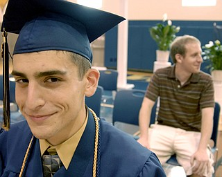 Front, Zachary Matisi, 17, was the second person in his family to be named valedictorian of his class. The first was his brother, John, rear, who graduated from Lowellville High School in 2006.