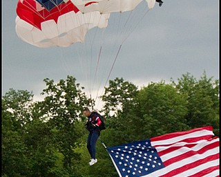 6.17.2008 Jimmy Drummond, resident and firefighter of Youngstown floats to the field to start off the Mahoning Valley Scrappers' season opener at East Wood Field, Tuesday evening. Drummond has been sky diving since 1993 and holds the title of National Accuracy Champion.