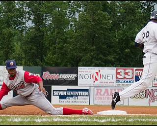 6.17.2008 Scrappers batter Isaias Velasquez beats the throw as Crosscutter infielder Jeremy Hamiton leaves the bag during Tuesday's season opener at Eastwood Field.