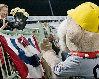 6.17.2008 Mitchell Mort (7), of Marshfield Wisconsin, waves to Scrappy the mascot  during a game between the Mahoning Valley Scrappers and the Williamsport Crosscutters Tuesday night at Eastwood Field. Mort and his family are visiting relatives in Howland where his father grew up.