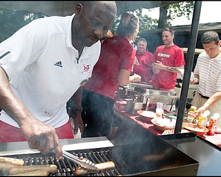 6.24.2008 Jerome Jones, of Youngstown cooks sausages for guests at the DeBartolo Golf outing at the Youngstown Country Club, Tuesday morning.