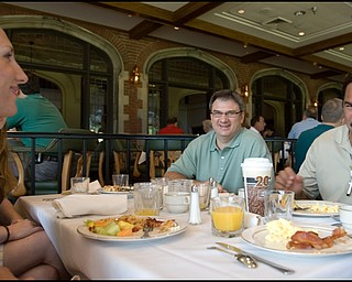 6.24.2008 Dan Deafino (right), Curt Peschae (center), and Jessica Mollally (left), all from Cleveland, eat breakfast before hitting the course for the DeBartolo Golf outing at the Youngstown Country Club, Tuesday morning.