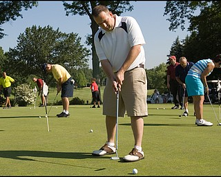 6.24.2008 Mike Kapics, of Youngstown, practices his putting before taking to the course for the DeBartolo Golf outing at the Youngstown Country Club, Tuesday morning. This is Kapics second year participating in the event that benefits The Edward J. DeBartolo Memorial Scholarship Foundation, which has awarded more than $400,000 in the past ten years.