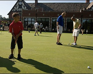 6.24.2008 Joe Nastasi, age 6 of State College Penn., practices his putting before taking to the course with his father who participates in the DeBartolo Golf outing at the Youngstown Country Club, Tuesday morning.