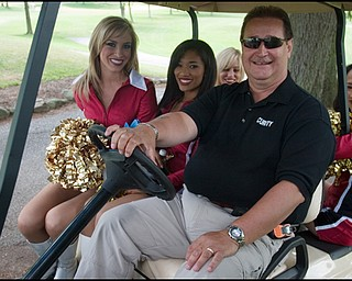 6.24.2008 Tim Gay drives a golf cart with 49ers Gold Rush Ambassadors following their sale of raffle tickets to raise funds for the Edward J. DeBartolo Memorial Scholarship Foundation.