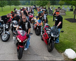 """7.6.2008 Matt Rohrbaugh (left) and Joe Mix (right), both of Austintown, stand with a total of more than 47 motorcyclists at Resurrection Cemetery off Raccoon Road in Austintown after paying respects at the grave of Matthew Adam Tynal. The stop was part of a ride organized by Mix, a member of """"The Lost Boyz,"""" a motorcycle group created in honor of Tynal, who passed away July 1, 2007 from a motorcycle accident in Youngstown."""