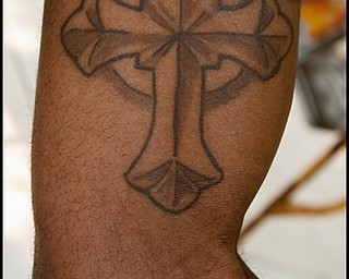 7.6.2008 Jimmy Hughes Jr, of Youngstown, shows the tattoo on his bicep he received in honor of Matthew Adam Tynal, who died from a motorcycle accident on July 1, 2007.
