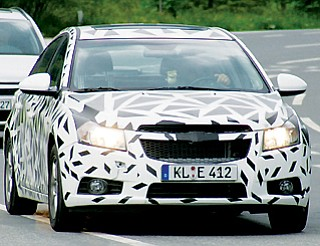 Spy photos of a camoflauged vehicle seen in Europe, believed to be the new Chevrolet Cruze.