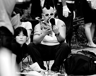 """""""Butch"""" sits in a camping chair in line outside Japanese mobile carrier Softbank's flagship store in Tokyo's Omotesando shopping district Wednesday, July 9, 2008 before the first sales of Apple's iPhone in Japan Friday. Gadget lovers are already camped out at a Tokyo store ahead of the global rollout Friday of the next-generation iPhone. But whether the Japan debut for the hit cell phone will score with anyone beyond a niche crowd remains to be seen, analysts say."""