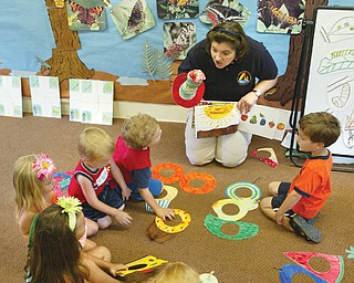 Carol Vigorito, a Mill Creek Park naturalist, leads a childrens program on buterflies at the Ford Nature Center Friday 7-11.