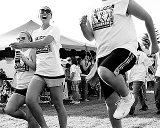 [7.11.2008] Jay Jorge (right), of Struthers, skips through Poland's 1st Annual Relay for Life alongside Tiffany Martin (center), of Boardman, and Ashley Kozic (left), of Lowellville. The three attended the event as team members from New Life Church.