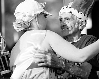"""[7.11.2008] Roberta McCollums, of Hillsville PA, embraces Andy Fusco, of the west side of Youngstown after they are named queen and king of the 1st Annual Poland Relay for Life in Poland. """"Every morning I put my feet on the floor, I thank God I've got another day,"""" says Fusco who battled cancer in 1999 and it has since gone into remission. McCollums has six types of cancer and has been battling the illnes for 22 years. """"Thats what we gotta do with cancer, keep busy,"""" said Fusco."""