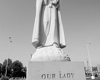 PATRON SAINT: A 10-foot statue of Our Lady of Mount Carmel is showcased at the church of the same name that is celebrating its century mark this year. The statue was dedicated in 1990 on the grounds at 343 Via Mount Carmel St., Youngstown.