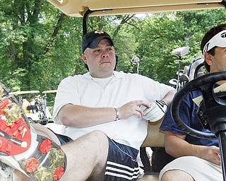 Golfers Dan Lamping, left, of Struthers and Jason Nespeca, of Youngstown, explain how high gas price and economy impact their playing of golf.