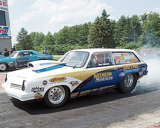 """7.5.2008  Bob Bastian, of Warren, pulls up to the starting line at Quaker City Drag Strip in his 1975 Vegas Station Wagon, a Super Pro Class dragster, with a personal best record of an 8.39 second quarter mile at 163 mph.   Bastian fixed and assembled the car, which he has been racing for 10 years, with the help of Abruzzi Transmissions, of Warren, and Koffel's Place who does the engine work.  Bastian has racing since 1964 primarily dragsters since 1964 with a brief stint of stock car racing.  Bastian and his daughter describe the community at the Quaker City Drag Strip as """"one big family"""" where """"the kids have grown up together on the weekends"""" and people gather not only on the track but also off the track in one case taking a trip to Six Flags.  """"I've thought about giving it up every weekend I lose,"""" says Bastian referring to his interest in drag racing, """" but 10 minutes later I'm ready to go again.""""  """"I've lived on adrenaline all my life,"""" says Bastian, who spent 31 years as a firefighter, and considers adrenaline and competition as major appeals of drag racing.  """"Me and my daughter are competitive together,"""" says Bastian, """" and she'll be a good racer when she gets in a big car."""""""