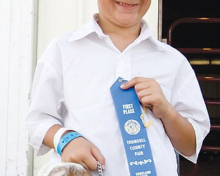 Jeremiah Adams, 10, poses with his blue-ribbon Nubian goat Ruby at the Trumbull County on Friday, July 11, 2008.