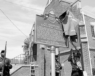 [7.12.2008] Vince Shivers, of Youngstown, unveils The Ohio Historical Society's marker recognizing St. Augustine Episcopal Chapel as a place of historical significance in the state as civil war re-enactors Steffon Jones (left) and Frederick Smith, both of Youngstown, represent the 5th USCT (United States Colored Troops) July 12, 2008. Lenora Berry chartered the church in  1907, making it the only known church in Mahoning County to have been chartered by an African American woman. Shivers began the work of requesting a marker at the church 5 years ago and is currently in the process of completing the application with the National Register of Historical Places.