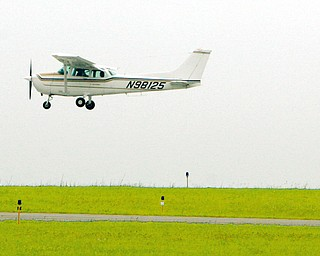Dan Miller, 17, of Howland, as he prepares for a touch and go as part of his flight class training with Matt Stroney.