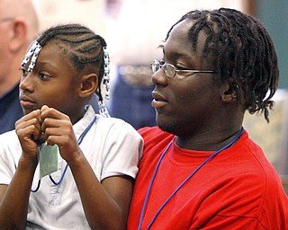 Keith Hayes counselor and DeShante  Allen 7,  watch intently as Sunshine Gospel.