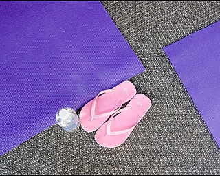 7.16.2008 Flipflops, water, and a mat at the Yoga for Kids summer workshop offered for free at Eastwood Mall by the Art Outreach Gallery and sponsored by American Gladiators Fitness Center.