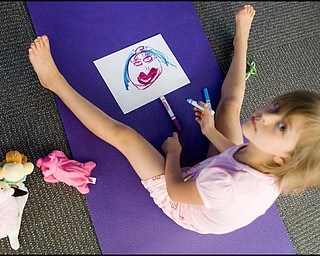 7.17.2008 Zoe Bowman (7), of Vienna, draws a picture of how she feels following a meeting of the Yoga for Kids Workshop at Eastwood Mall put on by the Art Outreach Gallery and sponsored by American Gladiators Fitness Center.
