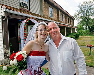 NEWLYWEDS: Robert Brooks wed Samantha Herbert at the Campbell Works company apartments, where he's lived for two years. As Samantha walked down her rose-lined sidewalk aisle toward Robert on Monday, local church bells rang int he background.