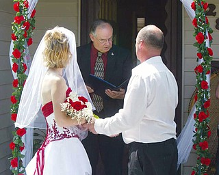 CEREMONY: Campbell Mayor John Dill conducts the ceremony of Samantha and Robert. Dill said it's nice that the former Youngstown Sheet and Tube Co. apartments are still being used and people are still moving into the buildings.
