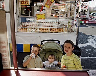 L-R Zachary Pipala, John Paul Pipala and Luke Pipala are about to order french fries to follow their snow cones at the Mt. Carmel Italian Festival in Youngstown, OH. Thursday, July 24, 2008. Daniel C. Britt.