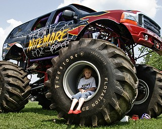 Melody Futchko, 6, of Niles plays on The Nightmare, a monster truck. At home Melody plays on her power wheels jeep. Jeep Fest at the Canfield Fair Grounds, Sunday, July 27, 2008. Daniel C. Britt.
