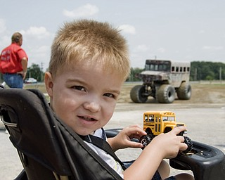"""Hunter Dailey, 2, of Lisbon, OH, waits in line for a ride in the monster truck """"Sergeant Smash,"""" at the Jeep Festival held at the Canfield Fair Grounds on Sunday, July 27, 2008. Daniel C. Britt."""