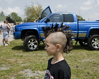 Isaac Collins, 6, of Hammondsville models his mohawk cut in preparation for the Jeep Festival at the Canfield Fair Grounds on Sunday, July 27, 2008. Daniel C. Britt.
