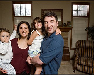 7.24.2008 Dr. Richard Esper, his wife, Dema, 4 year old daughter, Catherine, and 17 month old son, Anthony in their Austintown home.