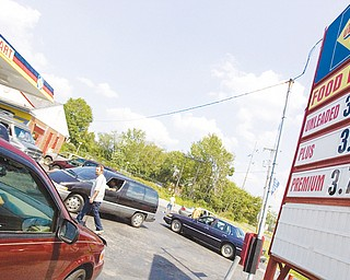 7.25.2008 Cars Line up for $3.59 gasoline at Ultimate Gas Station at the intersection of Belmont Ave and Madison Ave Expressway in Youngstown Friday afternoon. Geoffrey Hauschild