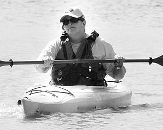Carol Vigorito Mill Creek Park Naturalist paddles a kayak on Lake Glacier thursday during a clean-up.