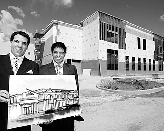 John Ferraro Jr and William M Ferraro show off the artist rendering of the  American Gladiators, is opening up an American Gladiators Fitness and Family fun center in the EastWood Mall.