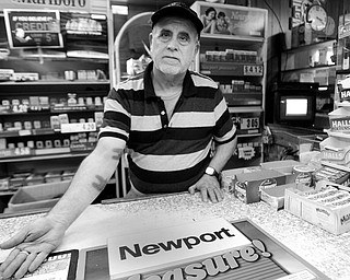 7.25.2008 Ahmed Dayem, who has been working at J&D Supermarket for over 2 years, displays wounds he sustained when a masked gunmen entered the store demanded money from the drawer and after receiving it continued to discharge two rounds. One shot was directed at Dayem's feet and caused minor injuries to both his right arm and right leg. Geoffrey Hauschild