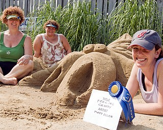 """1st place: L-R The team of Pam Urquhardt of Cleveland, Jo McCaskill of N. Jackson and Mary Ellen Bonacci of Austintown won the blue ribbon for first place (and $100.00) for their crap sculpture entitled """"feelin' crabby"""" at the sand sculpture contest in the Wick Recreation Area at Mill Creek Park on Sunday, July 27, 2008. The sculpture was inspired by a friend of Bonacci's who has a generally mean disposition. Daniel C. Britt."""