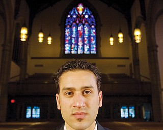 """7.21.2008 Jason Melidona, a.k.a. rapper """"Jay Mel"""" of Niles, poses for a portrait at Trinity United Methodist Church during shooting for the music video of his song, """"This Letter.""""  Geoffrey Hauschild"""