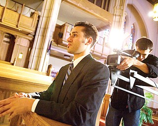 """7.21.2008 Jason Melidona, a.k.a. rapper """"Jay Mel"""" of Niles, is filmed by Videographer, Dan Mizicko, a resident of Vienna and senior at YSU majoring in Telecommunications, at Trinity United Methodist Church during shooting for the music video of his song, """"This Letter."""" Geoffrey Hauschild"""