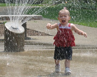 Abby Ruggles, age 18 months, runs through the fountain at the playground in Mill Creek Park. She is the daughter of Steve and Renee Ruggles of Austintown.