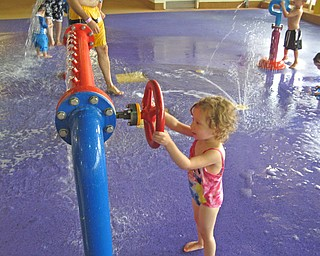 Lena Dill, 2, daughter of Valerie and Dustin Dill of Campbell, plays at an indoor water park in Niagara Falls.