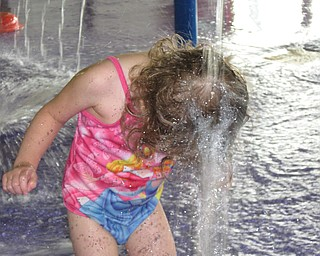 Lena Dlll, 2, daughter of Valerie and Dustin Dill of Campbell, soaks her head at an indoor water park in Niagara Falls.