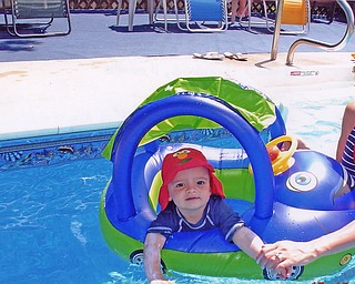 """James Lipjanic, 11 months, of Boardman has his first """"float"""" in his backyard pool. Photo taken by his father, James Lipjanic."""