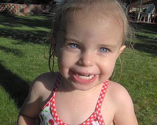 Elizabeth Nadzam, 2,  daughter of Nolan and Maria Nadzam of Boardman, enjoying the sprinkler on a hot summer day!