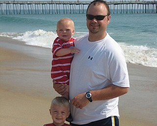Nick, Keaton and Kaden Mayhew of Boardman enjoy some beach time at the Outer Banks in North Carolina.