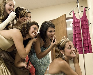 Contestants cram infront of a small mirror to prep for the Italian Queen pageant at the Downtown Italian Festival in Youngstown on Friday, August 1, 2008. Daniel C. Britt.
