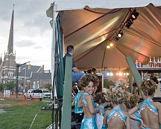 Savannah Berk, 9, of Warren glances toward the camera before performing with Natalie's Dance Troupe at the Warren Italian Festival Thursday, August 7, 2008. Daniel C. Britt.