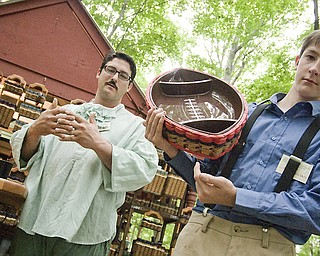 Joe Nelson, left, with his son Riley, 13, explain how some baskets are weaved to carry more load than others. Riley takes full credit, however, for the football idea. Shaker Craft Festival in Beaver Sunday, August 10, 2008.