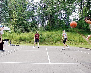 ON THE COURT: From left, Ben Stoyak, Jonathan Weisberg, Tony Pozzuto and Steve Wiesen play four square at Church Hill Park in Liberty. The four Liberty teens are trying to get into the Guinness World Records for the longest continuous game of four square. They start 9 a.m. Monday and hope to keep playing through 9 tonight.